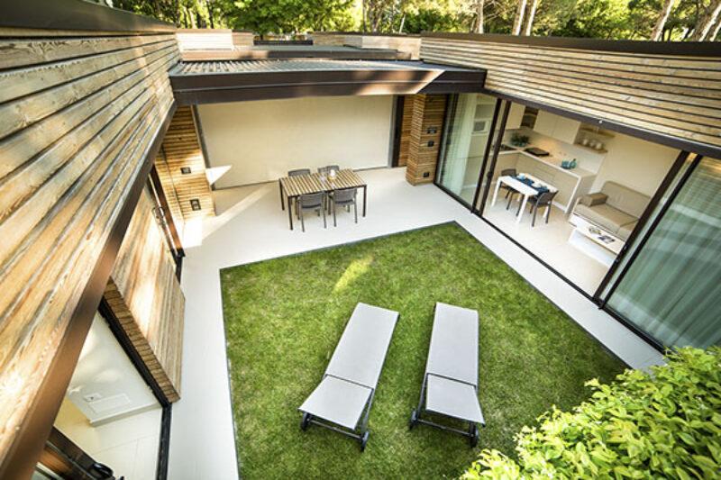 Villa mit Garten auf dem Campingplatz